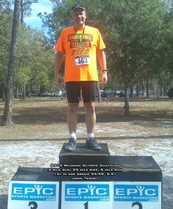 Your author John Tenney on the podium for his age class in the Wildman Olympic Duathlon