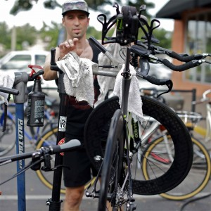Kyle Markel cleaning John Tenney's TT bike.